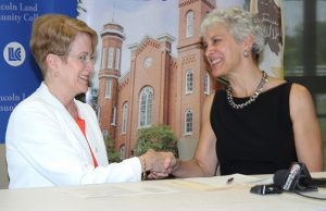 Charlotte Warren, Barbara Farley sign agreement