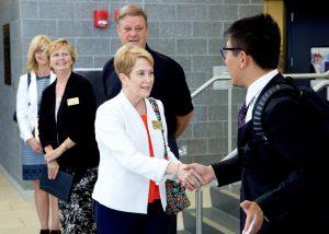 Dr. Warren greeting Chinese delegation