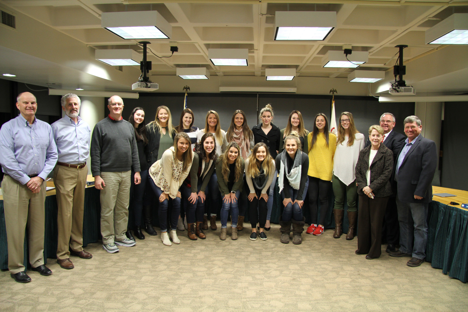 LLCC volleyball team at board meeting