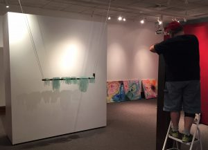 Bryon Hartley setting up artwork in museum