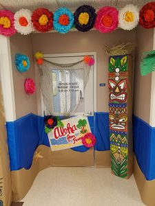 "Finance Dept. decorated door ""Aloha from Finance"""