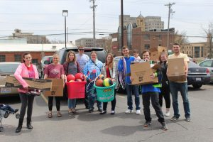 LLCC students collecting outdoor play equipment for YMCA