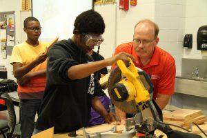 Bill Harmon with Career Launch teen in ag mechanics lab