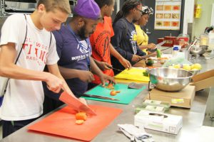 Career Launch teens cutting vegetables
