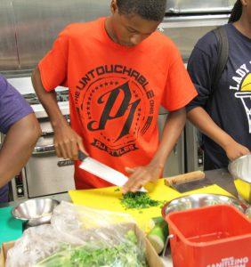 Career Launch teens dicing herbs
