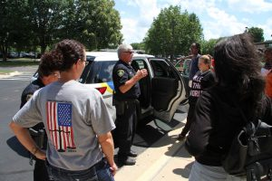 Career Launch teens checking out Springfield PD squad car