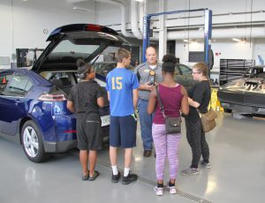 Brian Earley showing Career Launch teens the automotive technology lab