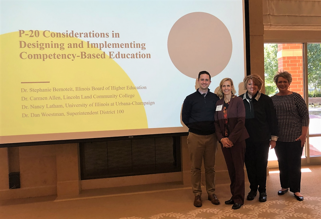 "Dr. Dan Woestman, Dr. Carmen Allen, Dr. Stephanie Bernoteit and Dr. Nancy Latham - panel presenters of ""P-20 Considerations in Designing and Implementing Competency-Based Education"