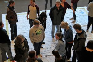 LLCC student GIS Day activity with giant floor map of Illinois