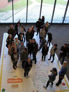 LLCC student activity on giant floor map of Illinois