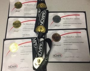 Gold Medallion Awards presented to Lincoln Land Community College, Springfield, Illinois for Communication Success Story or Community Relations Campaign 2018, Video Shorts 2018 and Folder 2018; silver for Print Advertisement 2018; and Bronze for Radio Advertisement 2018