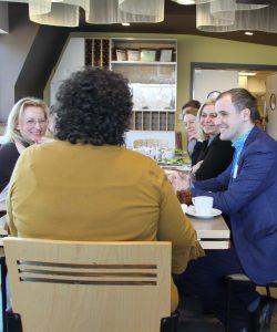 Dr. Judy Jozaitis with Ukrainian delegation at Bistro Verde