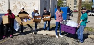 Education student loading up donations to take to St. John's Breadline