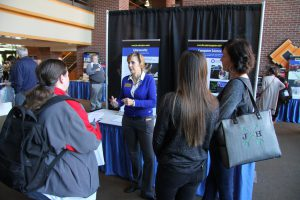 Dr. Carmen Allen speaking with prospective students and guests