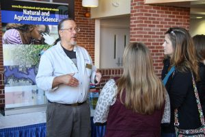 Dr. Gary Armour speaking with prospective students and guests