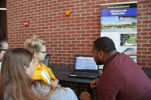 Rashawn Jones speaking with prospective students and guests