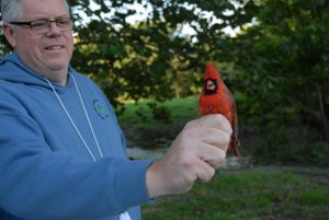 Tony Rothering holding cardinal