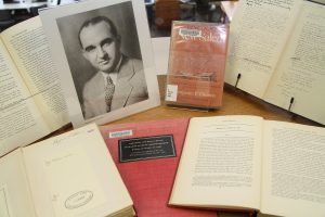Photo of Dr. Benjamin P. Thomas and books from his collection