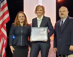 Dr. Carmen Allen accepted award.