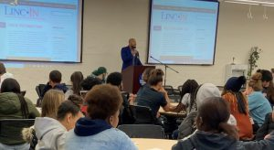 Patrick Moore talking with College Prep Summit students