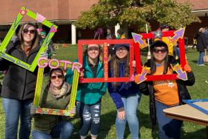 LLCC Nursing honor students holding photo frames at Girls on the Run