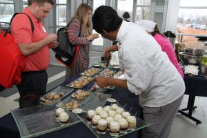 Culinary Arts students serving desserts