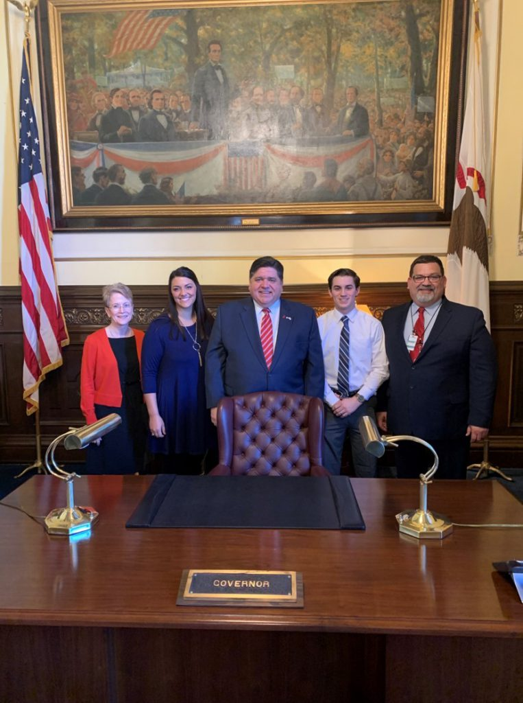 Dr. Charlotte Warren, Lauren Hernandez, Governor J.B. Pritzker, Brandon Ihlenfeldt and Dr. Brian Durham