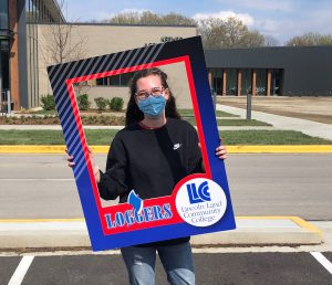Future student holding large Loggers picture frame
