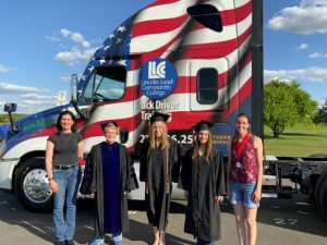 Dr. Warren with graduates in front of LLCC semi truck