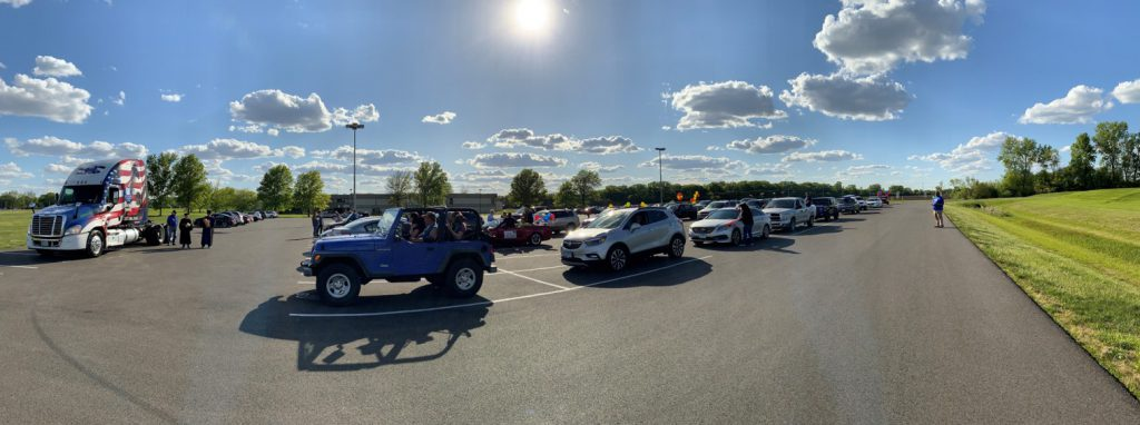 panoramic view of parade of vehicles lined up