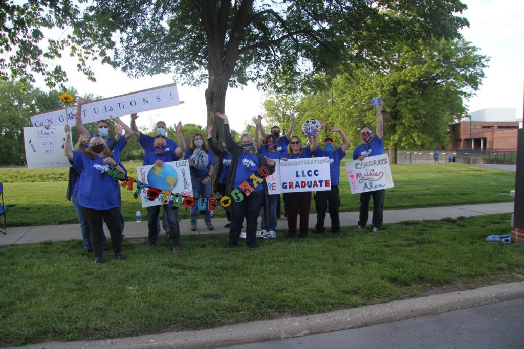 Faculty and staff along parade route