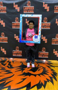Lanphier student who will be attending LLCC holding frame