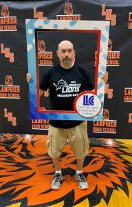 Lanpher staff member holding LLCC frame