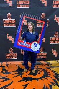 Lanphier student who will be attending LLCC holding photo frame
