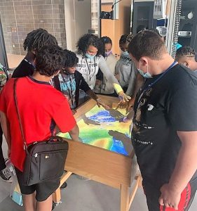Teens learning about topography and erosion with the virtual sand box.