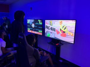 Students playing games in esports arena