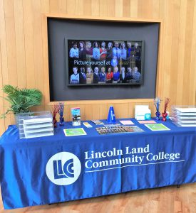 Lincoln Land Community College Welcome Week table summer 2021 with information and handouts.