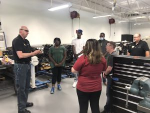 Prospective students in automotive engine lab