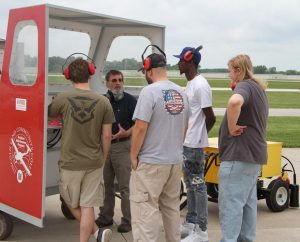 Prospective students learning about aviation