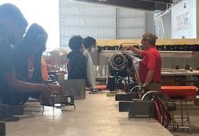 Students working in aviation hangar