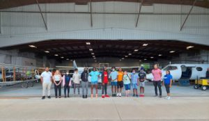 Boys & Girls Club youth with LLCC staff outside of aviation hangar