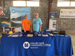 Tisha Miller and Dee Krueger at LLCC booth at fair.