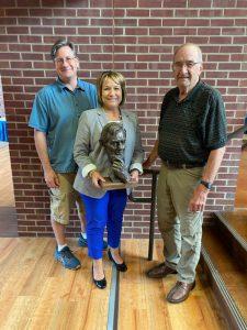 Ryan Roberts, Karen Sanders (holding Lincoln sculpture) and John McClarey