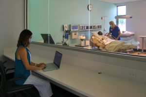 LLCC Nursing Instructor Bridgette Hudson observes nursing student Tracy Madonia as she practices skills in the labor/delivery lab of the new Nursing Education Center at LLCC.