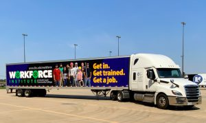 Semi with trailer that says: Workforce Institute at Lincoln Land Community College. Get in. Get trained. Get a job. www.llcc.edu/workforce