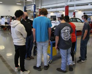 Brian Earley talking to students in auto tech lab